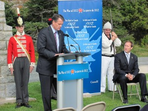 "Consul General Anton K. Smith speaking at War of 1812 commemorative event with Minister Peter McKay. Source: ""CG Anton K Smith"" by US Mission Canada"