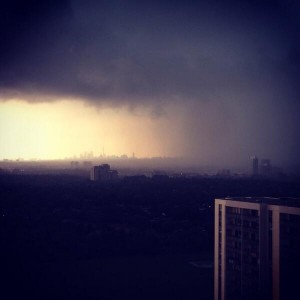 The storm with downtown in the distance. Photo posted by Amy Rensby.