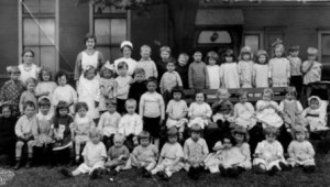 Group portrait of children and supervisors at the Vancouver City Crèche, c. 1917. Photograph by W.J. Moore, courtesy of City of Vancouver Archives, Reference no. Bu P48.