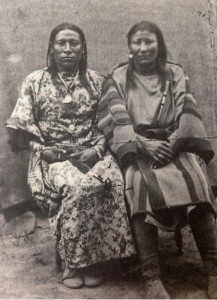 "Pictured in this photograph is Osh-Tisch (left), a Crow ""Boté"", which can be loosely translated as a ""transgendered person"" in our contemporary understanding. Osh-Tisch was an artist, medicine person and warrior amongst his people.  Photograph taken by John H. Fouch at Fort Keough, Montana Territory in 1877. From Roscoe, Third and Fourth Genders in Native North America (New York: St. Martin's Griffin, 2000), 33."