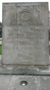 An image of the East York Civic Memorial, which is a slab that says '1914-1918' '1939-1945' In Grateful Tribute May Their Sacriice Be Not Forgotten. 1950 Korea 1953. And Our Special Forces