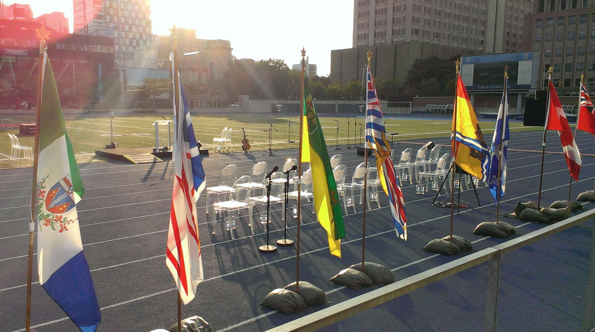 "At the ""In Memoriam"" event , July 31st 2014: the speakers' platform, seating for distinguished guests, and flags of Canada, its provinces, and territories."
