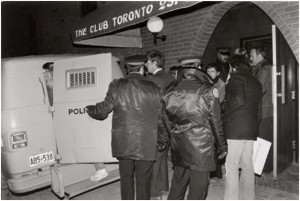 "Figure 1: Men from the bathhouse raids being arrested. Source: Jamie Bradburn, ""Bathhouse Raids Enrage Gay Community,"" Citiesintime.ca http://citiesintime.ca/media/toronto/downtown/bathhouse-ra/bathhouse-photo-then_sm.jpg (accessed June 2, 2015)."
