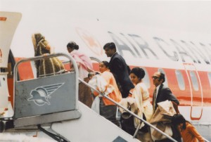 Ugandan Asian refugees board a plane for Canada, 1972. NHQ/AC Roger St. Vincent Collection PH-437.