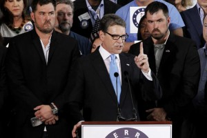Flanked by two former Navy Seals, Rick Perry announces his candidacy for the 2016 Republican nomination. June 2015. Mike Stone.