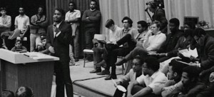 Kennedy Frederick speaking at student assembly at Sir George Williams. (From NFB Interview with Welwyn Jacob, click for link)