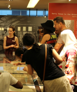 Danielle Manning, Outreach Officer at the Archives of Ontario, shows visitors the Archives' exhibit area at Doors Open Toronto 2016
