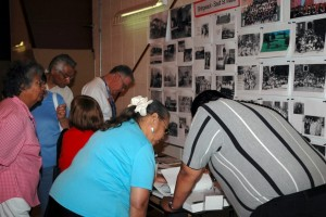 Gathering participants looking at residential school photographs during the Shingwauk 2006 Reunion.