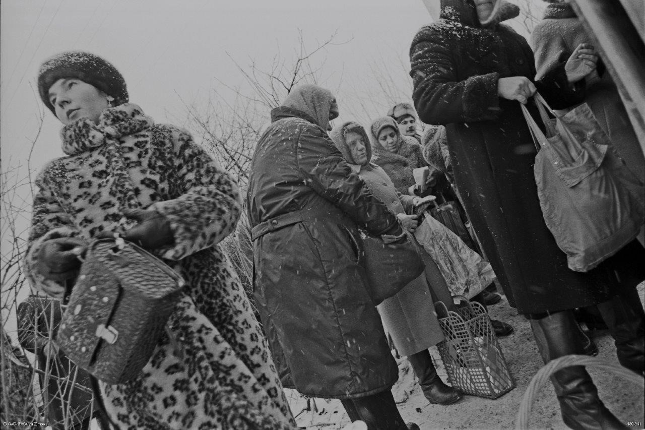 Rights & Realities Exhibit: ID Number: 439-341 Slide: 439-317-28 Women wait for milk to arrive from the local collective farm, Malin, Ukraine, 1995 (c)Global Affairs Canada/Iva Zimova
