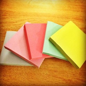 Stack of colourful post-it notes on a table