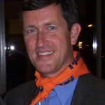 Sven Robinson with orange NDP bandanna around his neck.