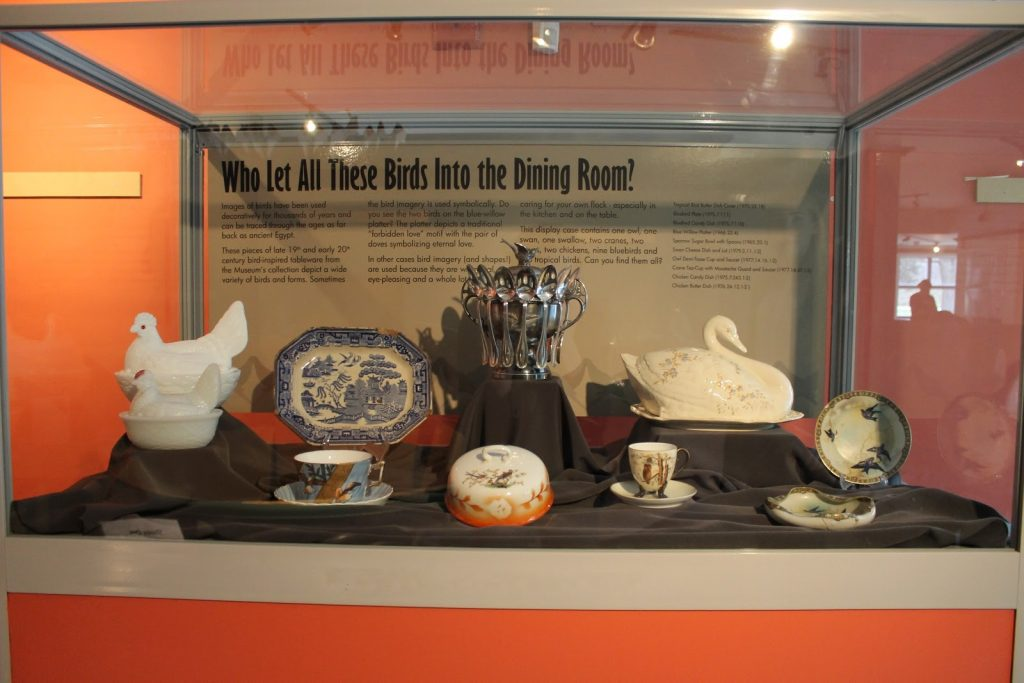 Display case with pottery and china inside.