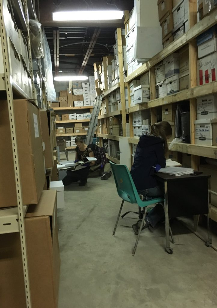 Two students doing research in an archives storage area