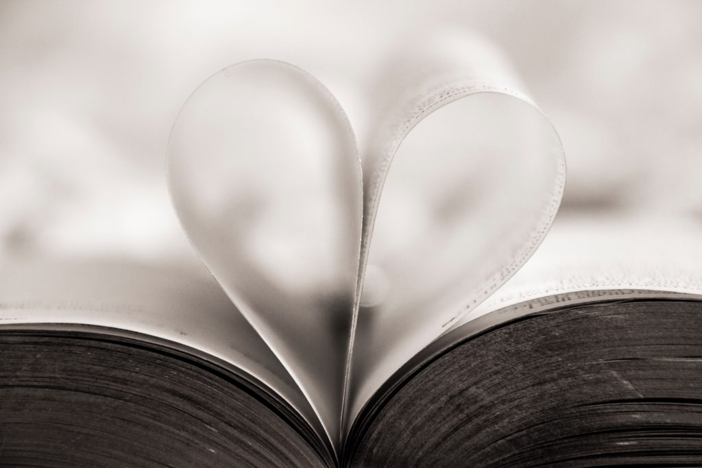 Book with folded pages to form a heart