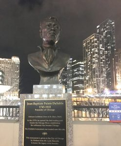 Bust of Jean-Baptiste Pointe DuSable, next to the DuSable bridge in downtown Chicago. (Photo by Groov3, Wikimedia Commons)