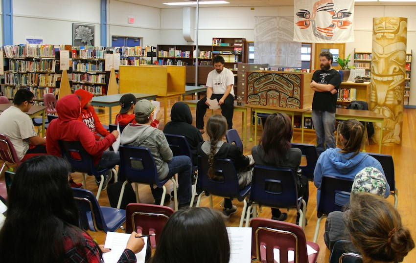 Two artists presenting to a classroom. Great Box Child is centered in the image.