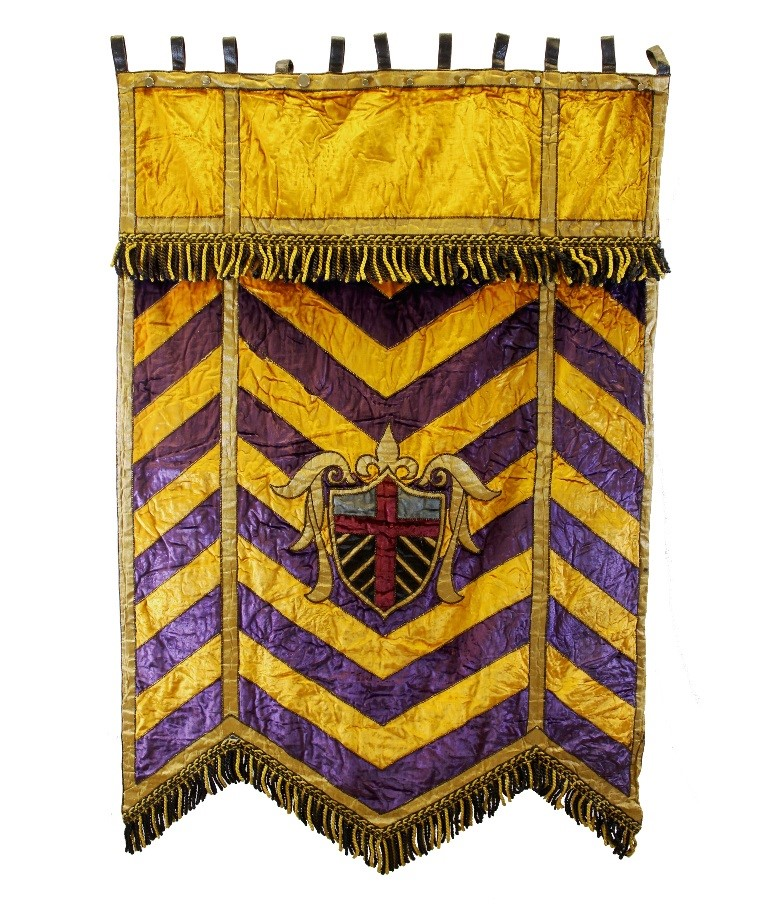 Purple and yellow chevron wall hanging with fringe on bottom