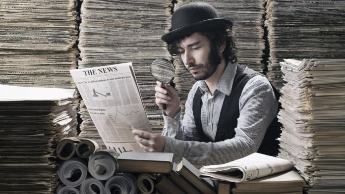 A young male historian, surrounded by stacks of old newspapers, using a magnifying class to read one. The historian is wearing a bowler hat and a waistcoast. He is not cool.