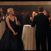 Dr. Abigail Chase in full-length ball gown at a gala.