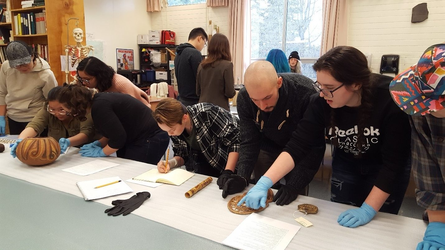 Students working with artifacts