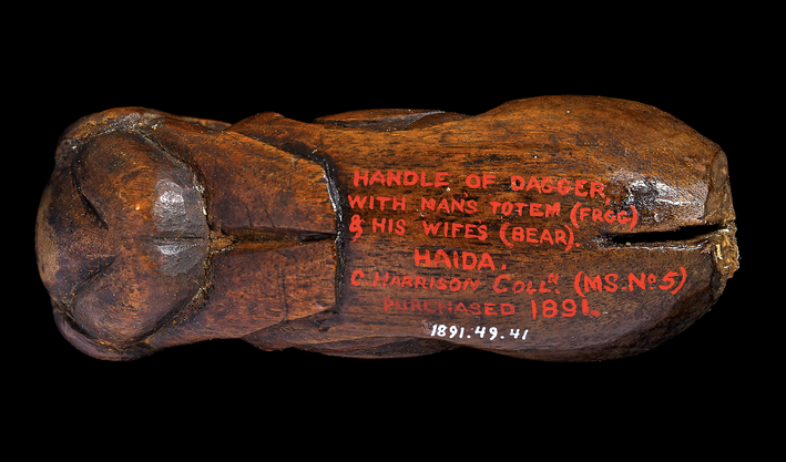 Wooden handle with red text