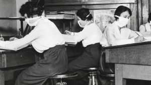 Three women working at desks during the 1918 Spanish Flu