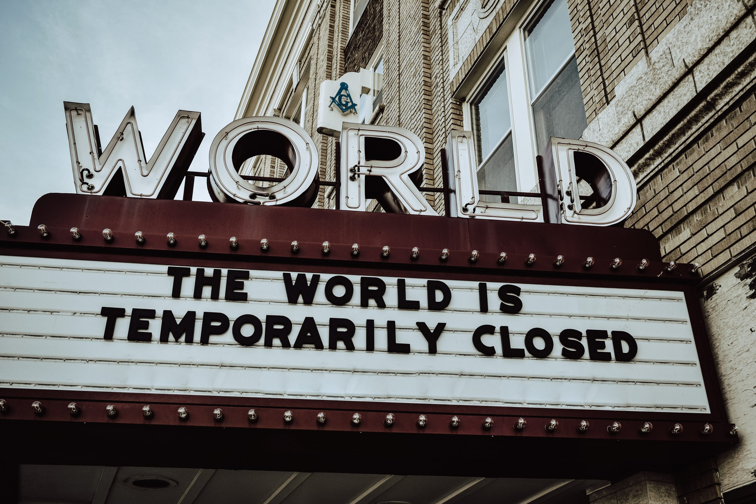 Sign reading the world is temporary closed