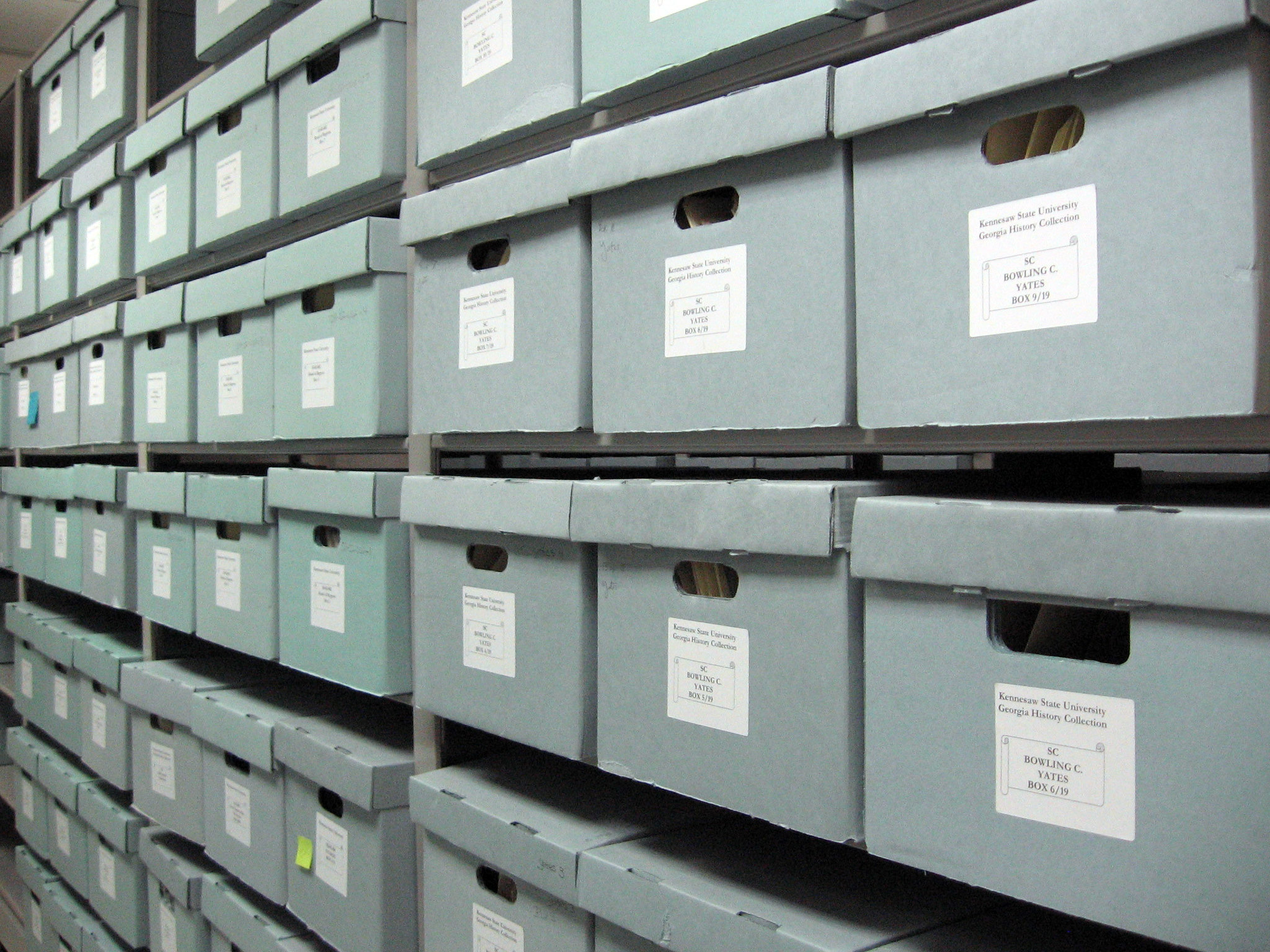 rows of archival boxes in storage