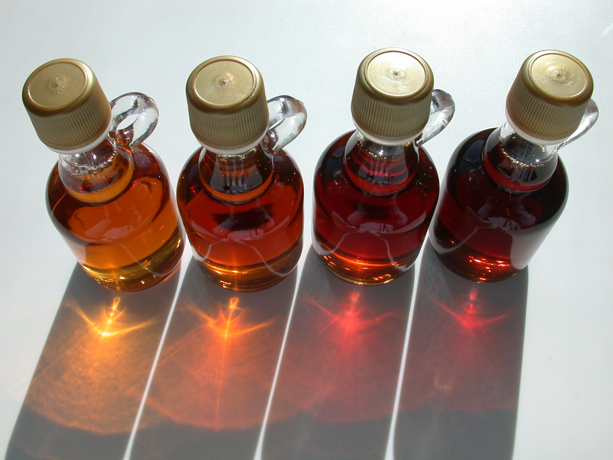Four bottles of maple syrup.