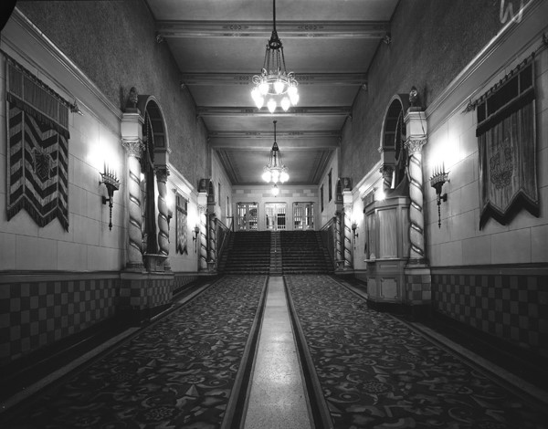 Interior hallway showing wall hangings in the Capitol theatre