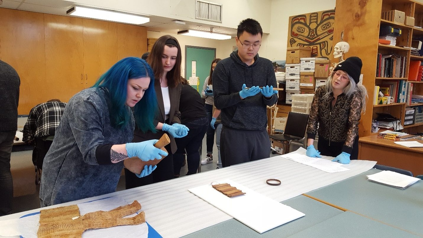 Group of students looking at artifacts